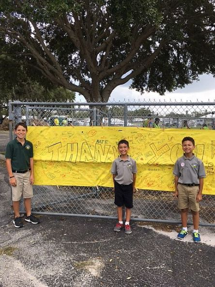 Signs are all over of huge thanks for Alabama Power crews in Florida. Students stand next to this sign from Palmetto Charter School. (contributed)