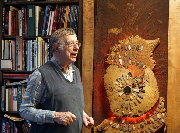 Pappas with part of his arrowhead collection. (Erin Harney/Alabama NewsCenter)