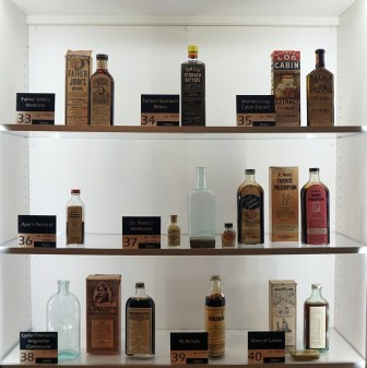Some of the bottles of quack medicine on display at the McWane Science Center. (Erin Harney/Alabama NewsCenter)