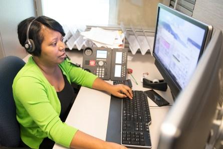 Tameka Jones answers calls in the Alabama Power Customer Service Center. (Phil Free / Alabama NewsCenter)