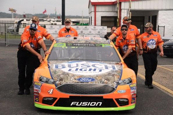 A crew pushes a car for inspection before the race. (Karim Shamsi-Basha / Alabama NewsCenter)