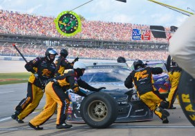 A pit crew rushes to change tires and refuel during the race. (Karim Shamsi-Basha / Alabama NewsCenter)