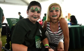 Kaitlyn Weaver, left, and Bethalyn Bailey show off their freshly done face painting prior to UAB's homecoming football game at Legion Field. The Alabaster residents were among about 100 Children's Harbor patients to whom UAB paid tribute by putting their names on the backs of specially designed player jerseys. (Solomon Crenshaw Jr./Alabama NewsCenter)
