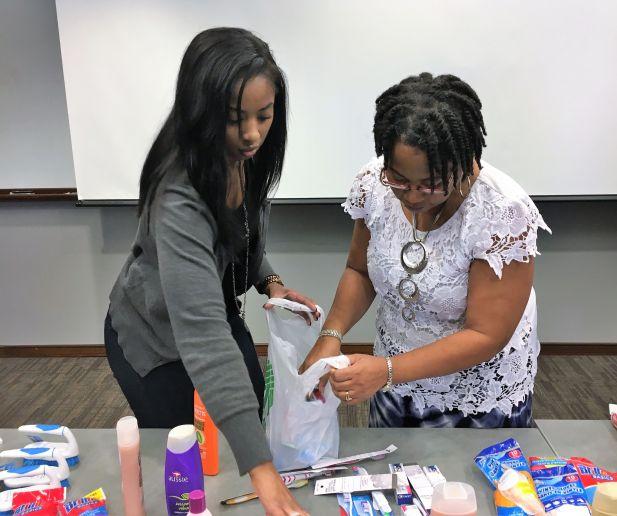 Magic City's Kiara Morgan (left) and Angela Juett sort items. (Donna Cope/Alabama NewsCenter)