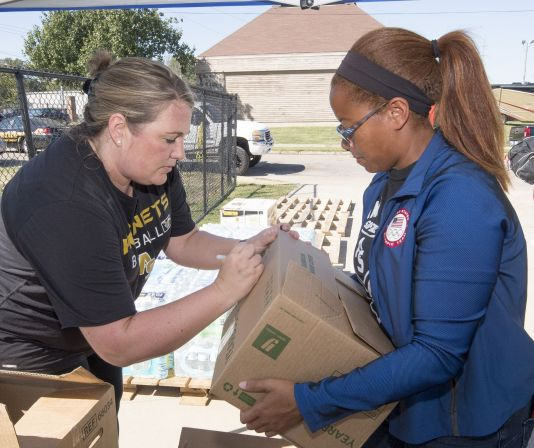 ASU volunteers mark packages. (David Campbell/Alabama State University)