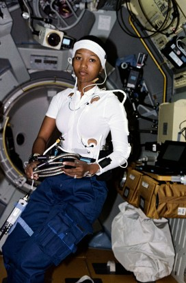 Astronaut Mae C. Jemison, science mission specialist, is pictured in the Spacelab-J Science Module, wearing a headband and other monitoring gear for physiological evaluation aboard the Space Shuttle Endeavour in 1992. Jemison, born in Decatur, Morgan County, was the first African American woman in space. (From Encyclopedia of Alabama, photo courtesy of the National Aeronautics and Space Administration)
