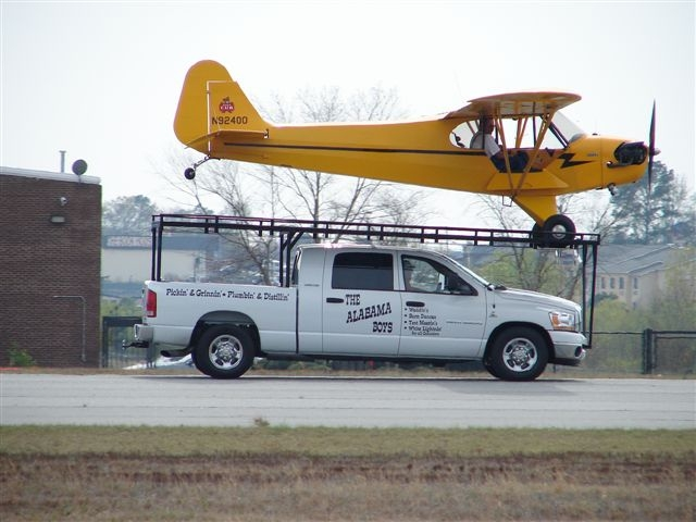 """Koontz lands his Pioer Cub on top of a truck, a stunt called the """"World's Smallest Airport."""" (Greg Koontz)"""