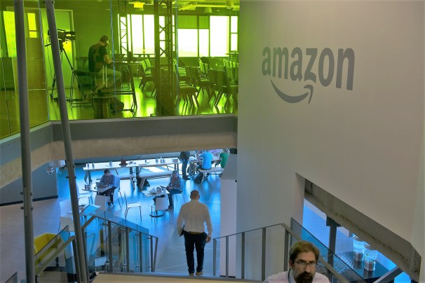 Employees and visitors walk and sit inside the Amazon.com Inc. office in Seattle. The company is well into the process of selecting a location for its second corporate headquarters. (Daniel Berman/Bloomberg)