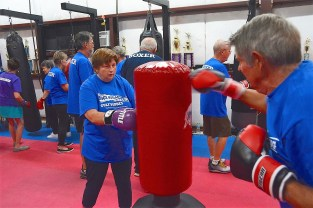 Participants exercise at Rock Steady Boxing in Gulf Shores. (Karim Shamsi-Basha / Alabama NewsCenter)