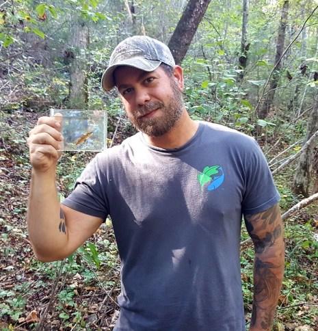 Jeffrey Drummond, stewardship director at the Freshwater Land Trust, displays a vermilion darter from Turkey Creek. (Freshwater Land Trust)