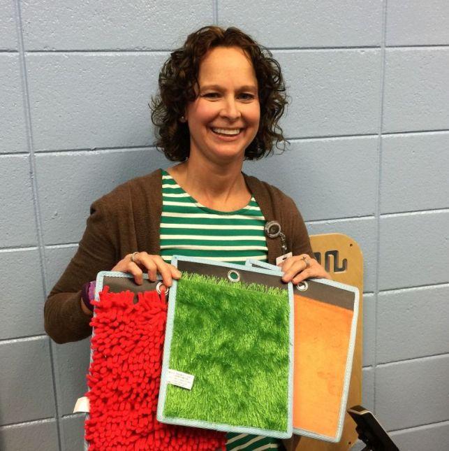 Nave displays textured mats for students. (Donna Cope/Alabama NewsCenter)