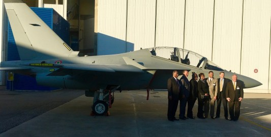 Officials from Macon County pose in front of an M-346 trainer just off the manufacturing line at the Leonardo factory in Venegono Superiore, Italy. (Made in Alabama)