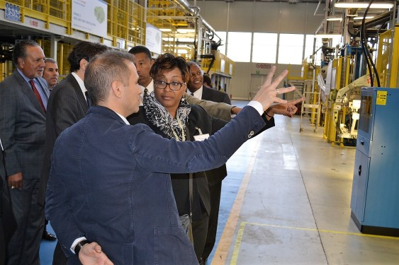 A Leonardo representative speaks with Jakki Brooks, superintendent of Macon County schools, during the tour of the company's aircraft factory in Venegono Superiore, Italy. (Made in Alabama)