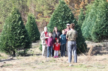 Matt Carter's family poses for a family portrait before employees of Murphy's Christmas Tree Farm cut their tree. (Robert DeWitt / Alabama NewsCenter)