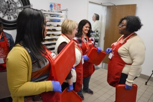 Salvation Army volunteers are ready to serve a Thanksgiving meal to a roomful of people. (Karim Shamsi-Basha / Alabama NewsCenter)