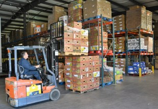 The Food Bank of East Alabama distributes 16 tractor-trailer loads of food every month to organizations that feed the hungry. (Karim Shamsi-Basha / Alabama NewsCenter)