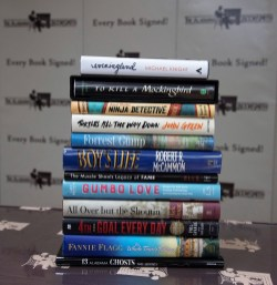 This stack of books by Alabama writers includes a literary milestone, a classic memoir, a cookbook, books for young readers, sports and music writing, ghost stories and top-notch short fiction, among other things. (Brittany Faush / Alabama NewsCenter)