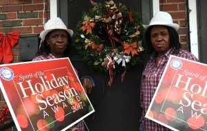 Identical twins Irma Parks, left, and Norma Parks received their Spirit of the Holiday Season Awards on Friday. (Solomon Crenshaw Jr. / Alabama NewsCenter)