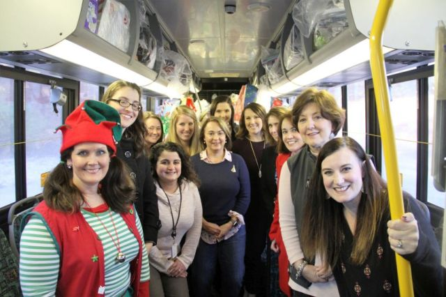 SCS employees load the 'Jingle Bus' with presents Dec. 11. (Anne Lugar, SCS)