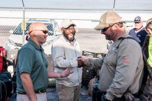 Sharing a few laughs before the work begins. (Nik Layman/Alabama NewsCenter)