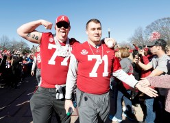 Alabama offensive linemen Matt Womack (77) and Ross Pierschbacher (71) celebrate with fans. (Amelia B. Barton)