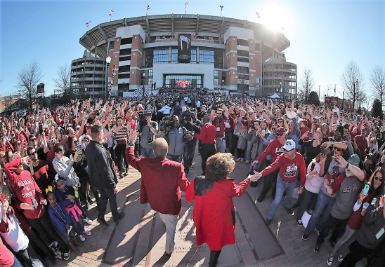 Nick and Terry Saban celebrate with fans. (Kent Gidley)