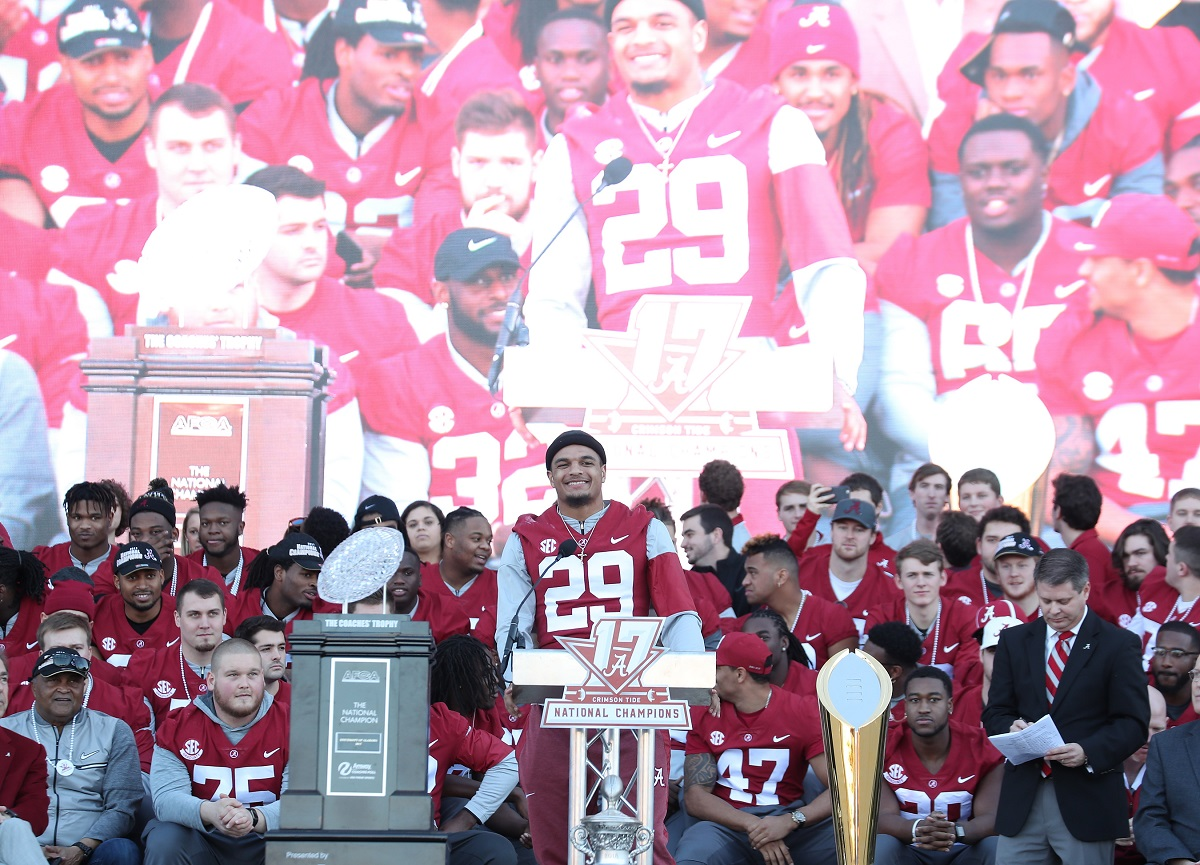 Minkah Fitzpatrick (29) speaks at the national championship celebration. (Kent Gidley)