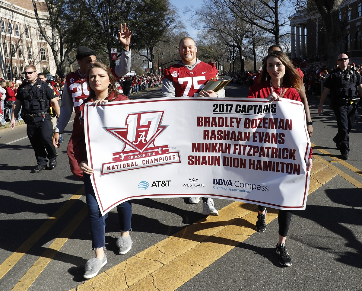 Alabama offensive lineman Bradley Bozeman (75) marches with fellow team captains in the parade. (Robert Sutton)