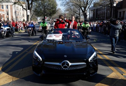 Nick and Terry Saban ride in the national championship celebration parade. (Robert Sutton)