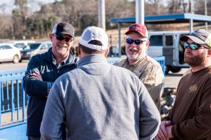 Alabama Power crews share a laugh before boarding their plane. (Nik Layman/Alabama NewsCenter)