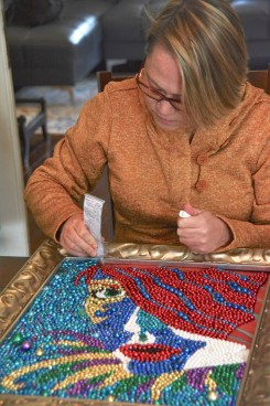 Kathleen McCarron's paintings made with Mardi Gras beads don't necessarily have Mardi Gras subjects, but this one does. (Karim Shamsi-Basha / Alabama NewsCenter)