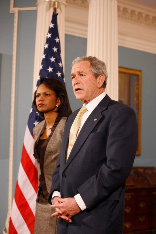 President George W. Bush, with U.S. Secretary of State Condoleezza Rice, talks with reporters Monday, March 24, 2008 in the Department of State in Washington, D.C. (White House photo by Eric Draper, Wikipedia)