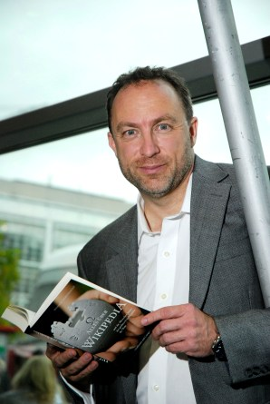 Jimmy Wales with German Wikipedia book #1, 2011. (teutopress/Thomas Gebauer; Wikipedia)
