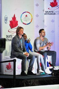 Skating coach and former Olympic skater John Zimmerman IV, left, sits with Vanessa James and Morgan Ciprès at a competition. The trio is headed to next month's 2018 Winter Olympics, and Zimmerman believes James and Cipress are contenders for medals. (Susan D. Russell / International Figure Skating)