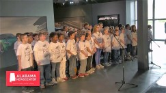 "Vance Elementary School students sing ""Alabama"" at the PastPort launch. (Alabama NewsCenter)"