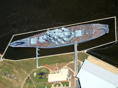 """An aerial view of the USS Alabama Battleship Memorial Park in Mobile, Mobile County. (From Encyclopedia of Alabama, photograph by Kevin """"Elvis"""" King)"""