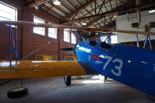 Restored Stearman PT-17 biplane on display in Hangar 1. (Erin Harney/Alabama NewsCenter)