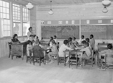 Classroom showing varying ages of students in primary grades in school, Prairie Farms, 1939. (Photograph by Marion Post Wolcott, Library of Congress Prints and Photographs Division)