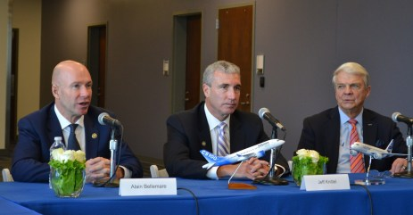 Bombardier CEO Alain Bellemare, left, speaks at a C-Series briefing in Mobile as Airbus executives Jeff Knittel, center, and Allan McArtor look on. (contributed)