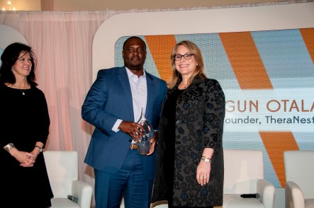 Shegun Otulana of TheraNest, left, receives a Power of Leadership award from Stephanie K. Cooper, vice president of Public Relations for Alabama Power. (Billy Brown / Alabama NewsCenter)