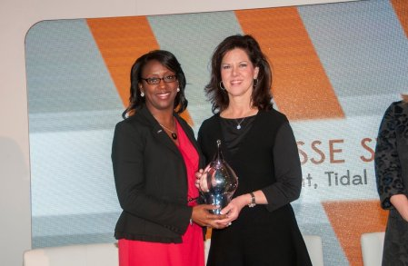 Charisse Stokes of Tidal IT Solutions,left, receives a Power of Leadership award from Leslie Sanders, vice president of the Southern Division for Alabama Power. (Billy Brown / Alabama NewsCenter)