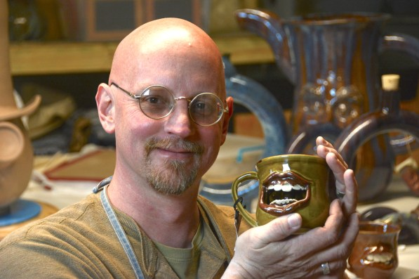 Clay artist Brian Corry uses his hands to create unique pieces of art such as this face jug. (Karim Shamshi-Basha)