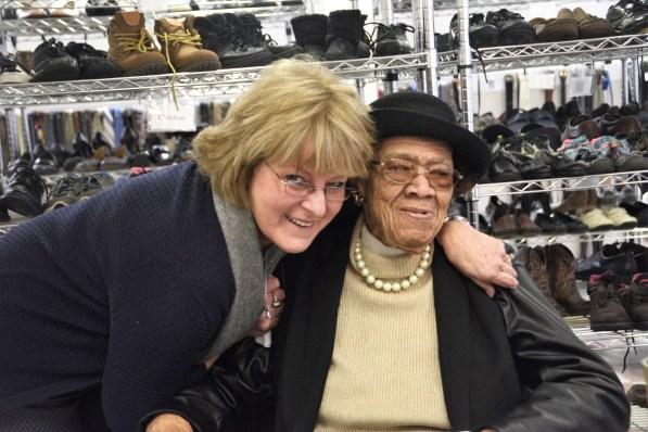 Gayle Monk, executive director of Committee on Church Cooperation gives 99 year-old Annie Woodruff a hug. (Karim Shamsi-Basha / Alabama NewsCenter)