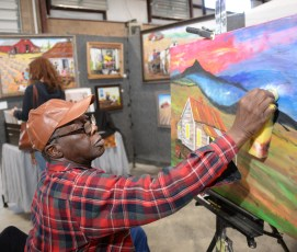 Folk artist Maurice Cook, of Hoover, demonstrates during last year's festival. (Michael E. Palmer)