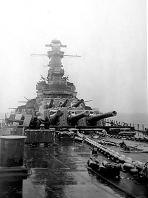 Guns are seen on the deck of the battleship USS Alabama (BB-60) during a snowstorm in January 1943. (From Encyclopedia of Alabama)