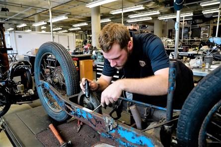 Mitch Cobb, restoration specialist at Barber Vintage Motorsports Museum, tackles his latest challenge. (Mark Sandlin / Alabama NewsCenter)