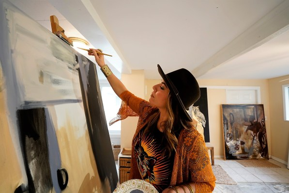 S.A. Maples begins an abstract painting without preconceptions, and it ends up expressing something she feels but can't express in words. (Mark Sandlin/Alabama NewsCenter)
