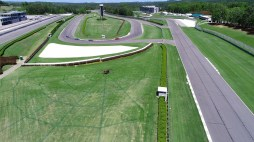 Racers need not fear. That's just Charlotte minding her web next to the track. (Barber Motorsports Park and Museum)