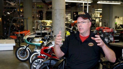Denis McCarthy is one of the restoration specialists at Barber Vintage Motorsports Museum. (Mark Sandlin / Alabama NewsCenter)