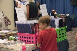 A young fan decides which merchandise he wil collect. (Brittany Faush / Alabama NewsCenter)